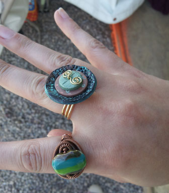 Eva Sherman's Wire Wrapped Ring and Meredith Arnold's Polymer Clay Ring, taught in class at Tucson
